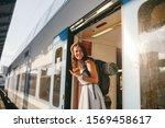 Woman Peeking Out Train. Woman...