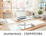 Background image of modern office interior with laptop on wooden table, workplace design concept, copy space