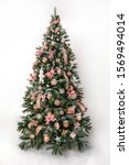 Magnificently decorated christmas tree in front of a white backround - stock photo