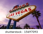 Stock photo famous las vegas welcome sign at sunset with palm trees in the background 15697093