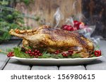 baked goose on wooden table.... | Shutterstock . vector #156980615