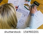 a woman with unpaid bills has... | Shutterstock . vector #156983201