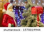 A Big Santa Claus Figure Is...