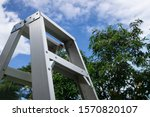 Rusty Metallic Ladder On Cloud...