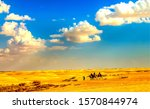 Small photo of Camel caravan in sand desert. Camel caravan in desert. Camel caravan view. Sand desert camel caravan scene
