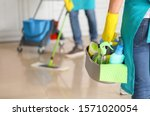 Female janitor with cleaning...