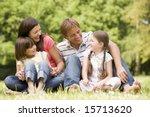 family outdoors smiling   Shutterstock . vector #15713620