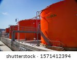 Orange Metal Storage Tanks Wit...