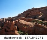Famous Partition Arch, two round holes in massive red rock, Arches National Park, Utah