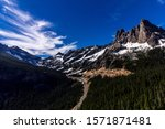 Liberty Bell mountain with blue sky and trees with snow on the North Cascades Highway pass near Sedro Woolley, Washington, Pacific Northwest, United States.