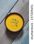 bowl of pumpkin soup on rustic... | Shutterstock . vector #157205651