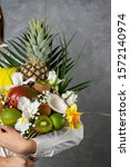 Small photo of Tasty bouquet, eatable fruit bouquet eatable vegetarian bouquet. Exotic fruits gifts. beautiful composition from vitamins fruits.