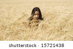 pretty young woman in the grass - stock photo