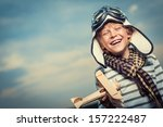 Laughing Boy With A Plane On...
