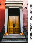 Small photo of A stoop decorated for Halloween. Manhattan, New York.