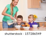mother is pouring milk to her... | Shutterstock . vector #157286549