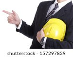Engineer stand and use finger point something  with clipping path - stock photo
