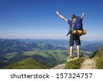 tourist on the mountain top.... | Shutterstock . vector #157324757