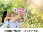happy young family spending... | Shutterstock . vector #157344551