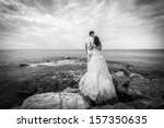 bride and groom standing at the ... | Shutterstock . vector #157350635
