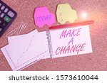 Small photo of Text sign showing Make A Change. Conceptual photo Create a Difference Alteration Have an Effect Metamorphose Desk notebook paper office cardboard paperboard study supplies table chart.