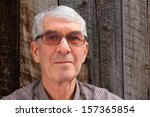 senior man with glasses and... | Shutterstock . vector #157365854