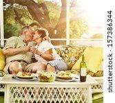 elderly married couple kissing | Shutterstock . vector #157386344