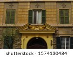 Small photo of Facade of an eighteenth-century building, antediluvian architecture in Rome, Italy.