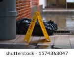 Small photo of Caution wet sign on the wet ground