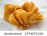 Small photo of Pastelito are popular pastries in Argentina and Uruguay. They are made with phyllo dough or puff pastry and filled with either quince jam or sweet potato jam. Then they are either baked or fried.