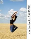 beautiful jumping woman over nature background - stock photo