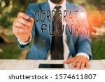 Small photo of Conceptual hand writing showing Corporate Flunky. Business photo text someone who works obediently for another demonstrating in company Businessman holds pen and points into copy space.