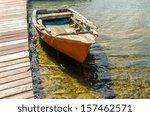Old Orange Boat By A Pier In...