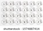 feminine floral badge letter... | Shutterstock .eps vector #1574887414