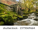 Old Mill With A Waterwheel...