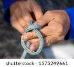Closeup male hands with knotted ...