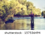 A person fly fishing in a river ...