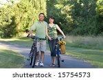 couple stands between bicycles... | Shutterstock . vector #15754573