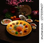 Small photo of chinese new year colourful lo hei yu sheng with smoked salmon , vegetables & sauces in gold big plate
