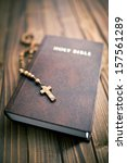 Holy Bible With Rosary Beads O...