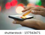 mobile phone in a woman's hand  ... | Shutterstock . vector #157563671