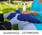 US military flag presentation at national cemetery - stock photo