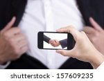 Businessman capture for check co ordinate by sharke hand  - stock photo