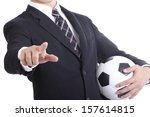 Football manager hold ball for command player for follow as planning with clipping path - stock photo