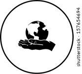world in the hand symbol | Shutterstock .eps vector #157654694