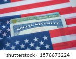 USA Permanent Resident (Green card) and Social security number (SSN) covered on American flag.