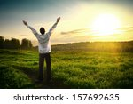 happy young man with hands up... | Shutterstock . vector #157692635