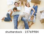 family lying on floor by open... | Shutterstock . vector #15769984