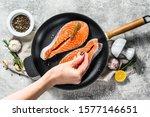 Chef Salts Raw Salmon Steak In...