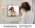 A Woman Is Combing Her Hair In...